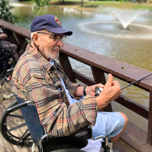 A resident smiling outside at Oxford Glen Memory Care at Owasso in Owasso, Oklahoma