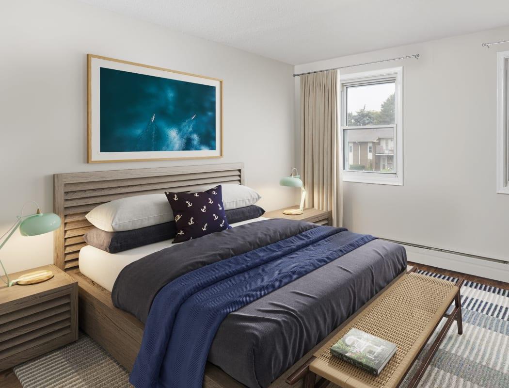 Model bedroom with tasteful decor at Georgian Court Estates in Burlington, Ontario