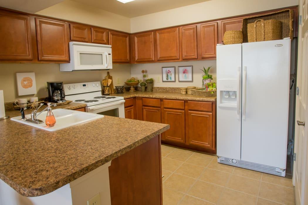 Kitchen with white appliances at Nickel Creek Apartments in Tulsa, Oklahoma