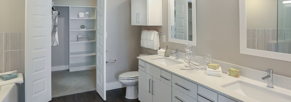 A large bathroom with a walk-in closet at Greenhouse in Houston, Texas