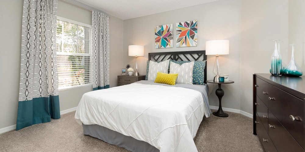 Spacious bedroom with large windows and lots of natural lighting during the day at The Avenue in Ocoee, Florida