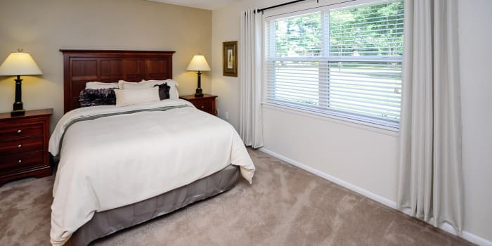 Enjoy a beautiful bedroom at Sherwood Village Apartment & Townhomes