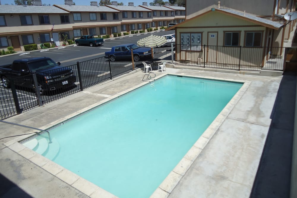Swimming pool area on a beautiful day at Olympus Court Apartments in Bakersfield, California