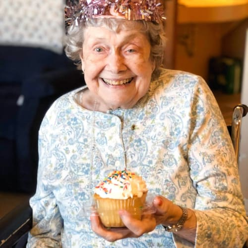 Resident holding a cupcake at The Oxford Grand Assisted Living & Memory Care in Wichita, Kansas