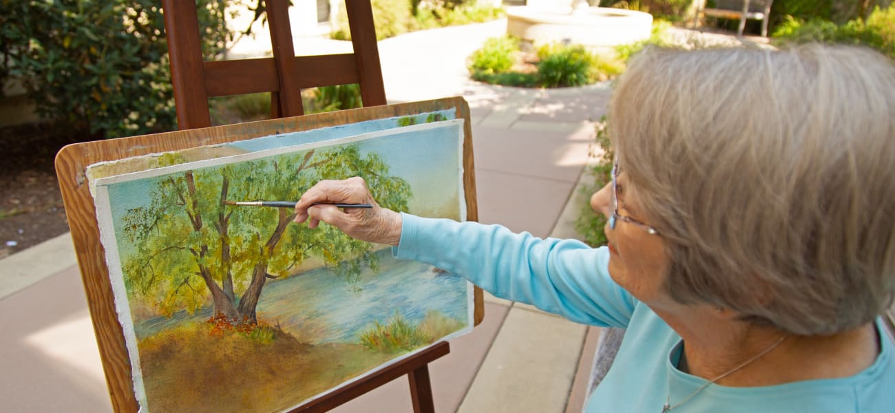 A resident painting at a Merrill Gardens community.