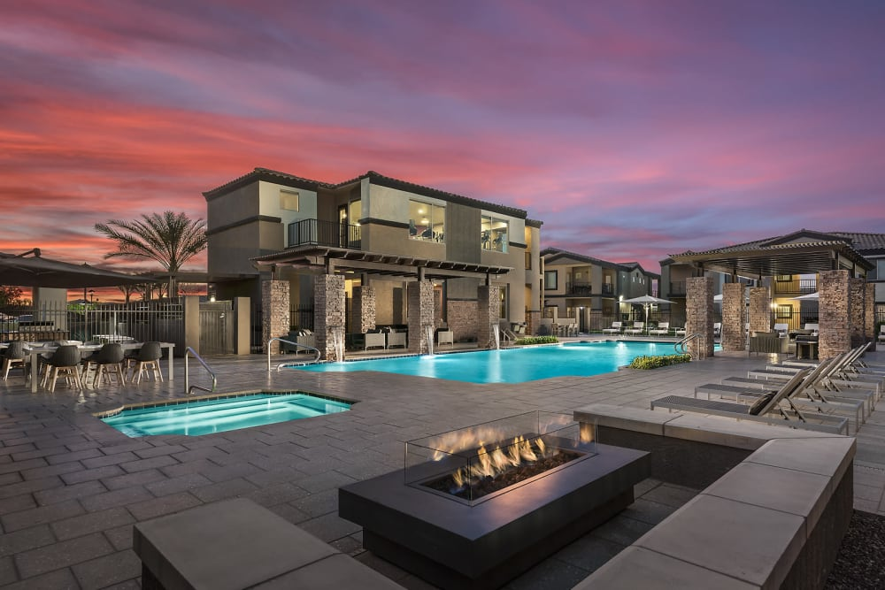 Resort-style swimming pool with fountains at The Maxx 159 in Goodyear, Arizona