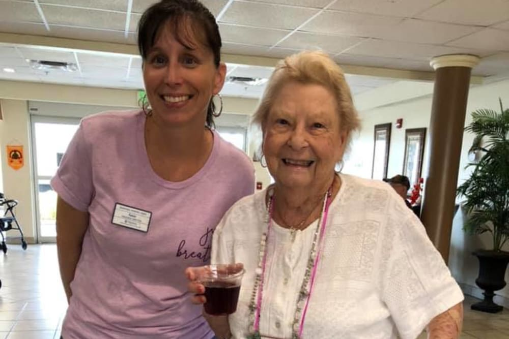 Smiling resident and staff member at Balmoral Assisted Living in Lake Placid, Florida