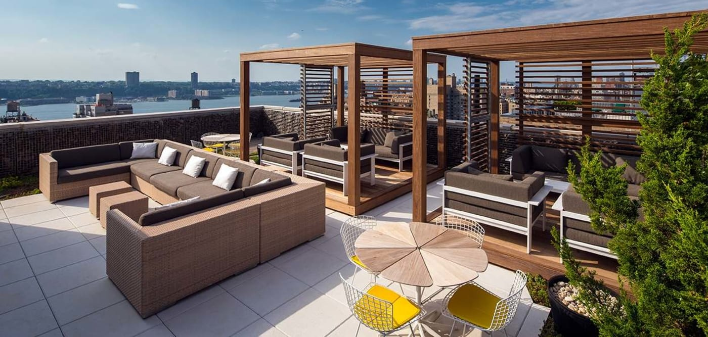 Roof-top patio with lounge chairs at The Larstrand in New York, New York