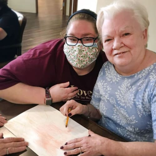 Resident coloring with crayons at The Oxford Grand Assisted Living & Memory Care in McKinney, Texas