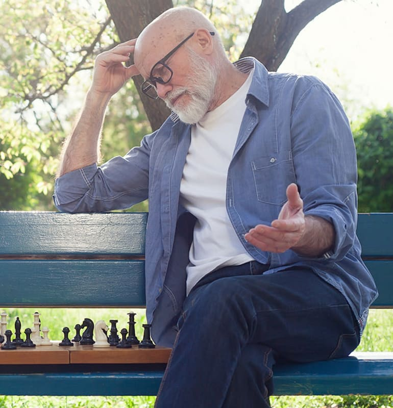 Seniors playing chess outside at Oakmont Gardens in Santa Rosa, California