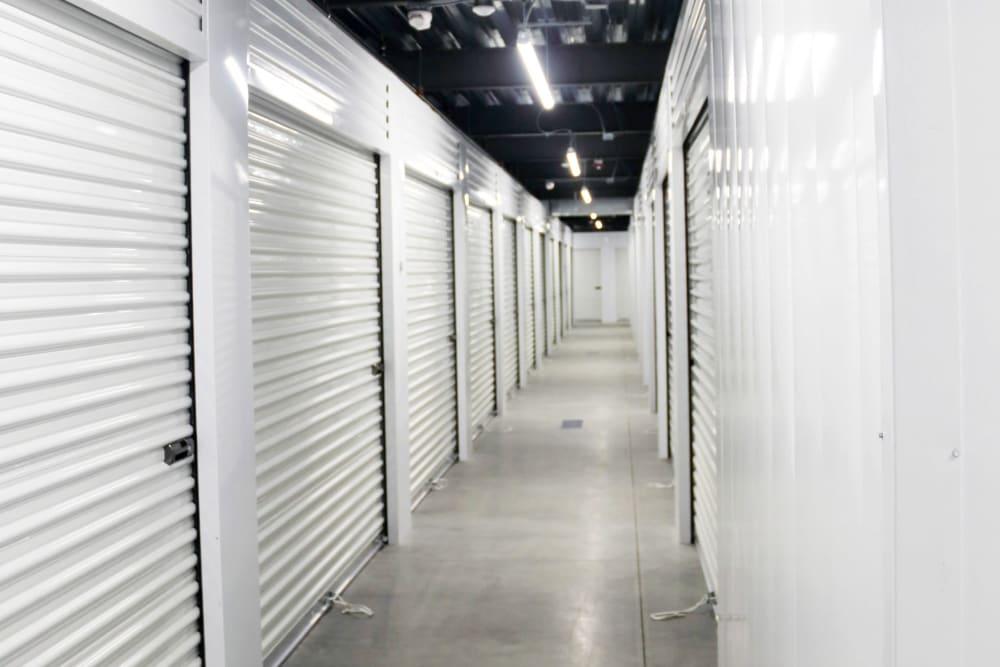 Well-lit hallways at 603 Storage - Hudson in Hudson, New Hampshire