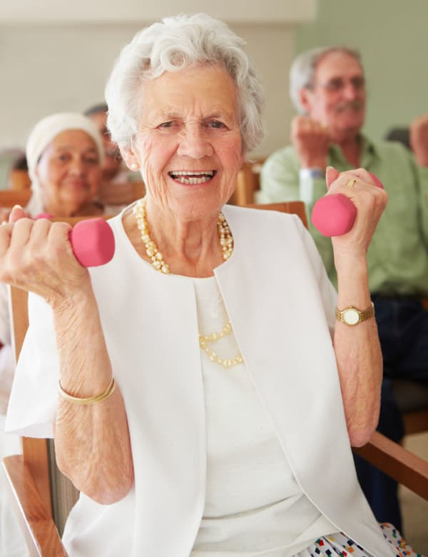 Woman exercising with weights at The Retreat at Port Orange in Port Orange, Florida