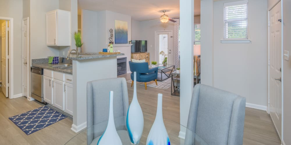 Open concept floor plan with hardwood floors and modern decor at The Mark in Raleigh, North Carolina