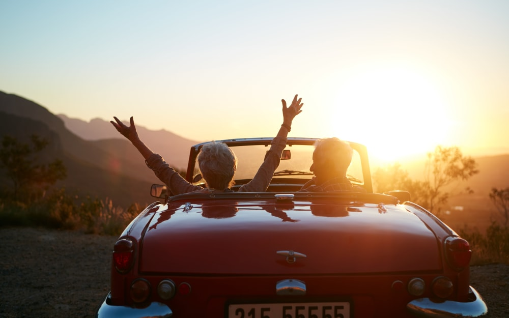 Independent living residents enjoying the sunset from their convertible near Carmel Village in Fountain Valley, California