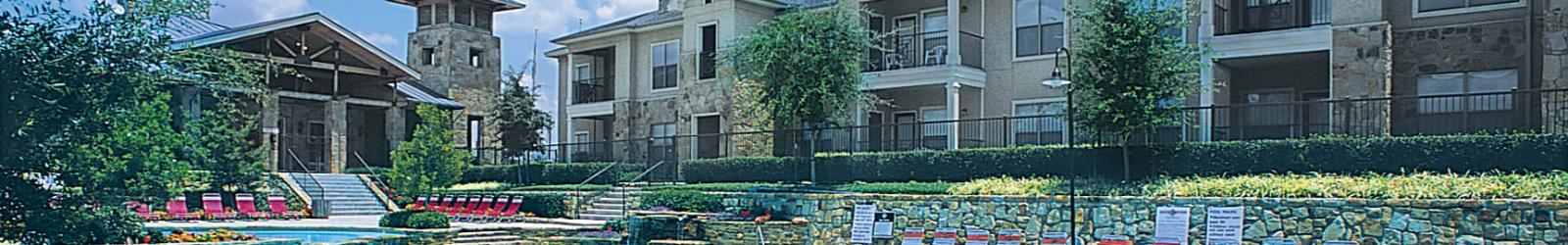 Parking at El Lago Apartments in McKinney, Texas