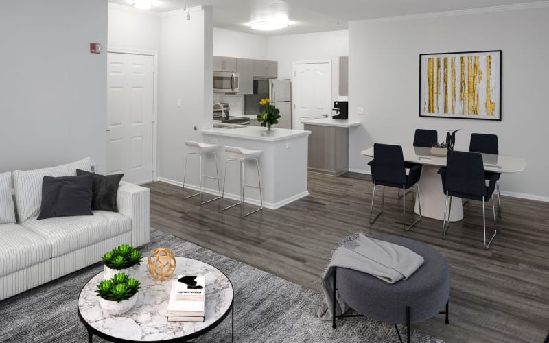 Spacious and bright living room, dining room and kitchen at The Grove at Orenco Station in Hillsboro, Oregon