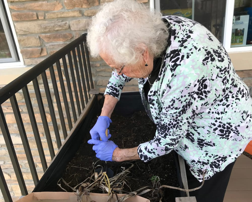 Resident planting a garden at Edencrest at Riverwoods in Des Moines, Iowa.
