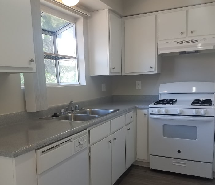Upgraded kitchen in model home at Sienna Heights Apartment Homes in Lancaster, California