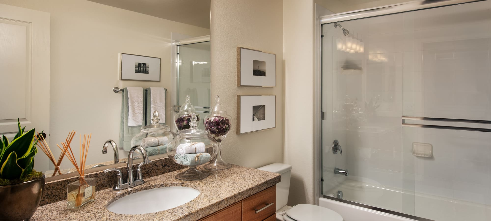 Large vanity mirror and granite countertop in bathroom of model home at San Paseo in Phoenix, Arizona