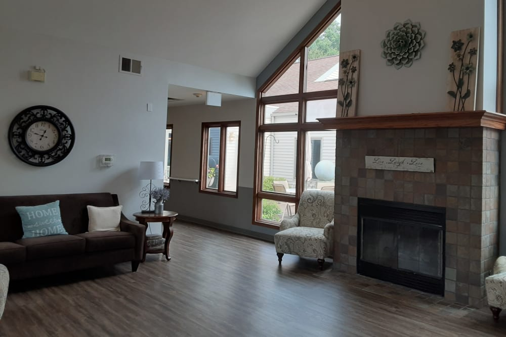 Comfortable resident sitting room with fireplace at The Atrium in Rockford, Illinois