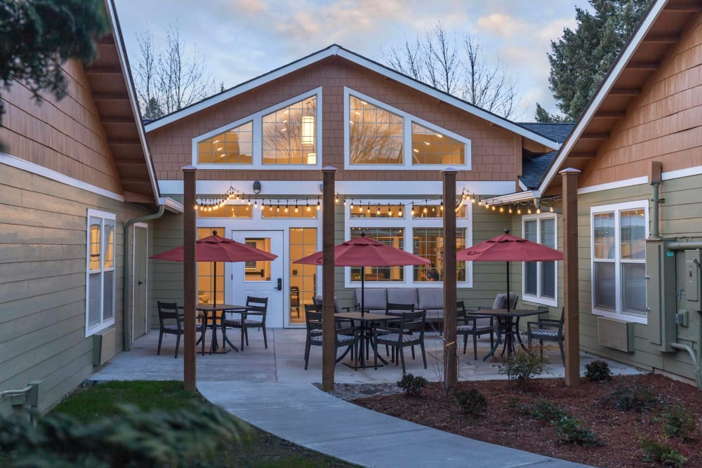 Beautiful back patio featuring string lights hanging above the tables at The Springs at Clackamas Woods in Milwaukie, Oregon
