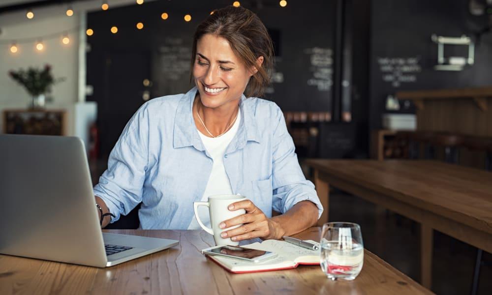 Resident working on their laptop in a local coffee shop near Oaks Minnehaha Longfellow in Minneapolis, Minnesota