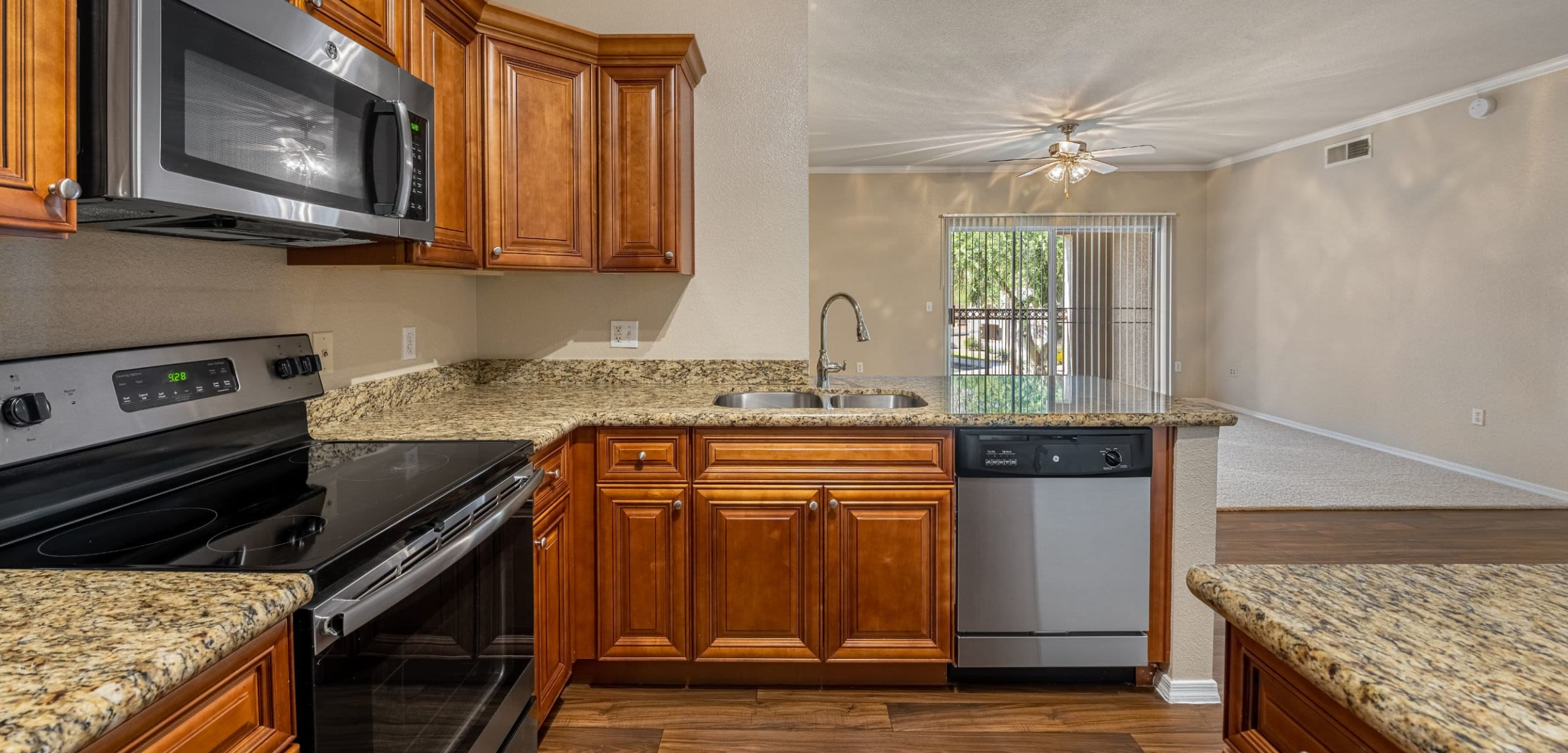 Modern kitchen with wood style floors at Azure Creek in Cave Creek, Arizona