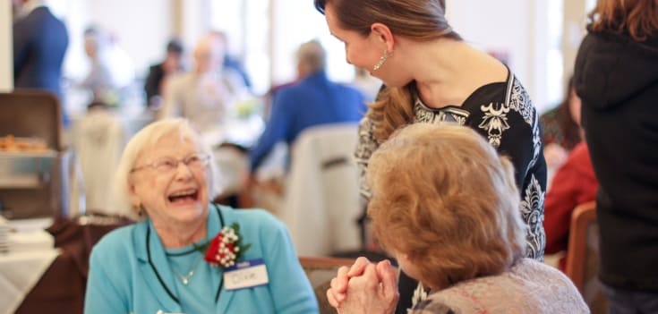 Residents at Merrill Gardens at Solivita Marketplace enjoying meal time together