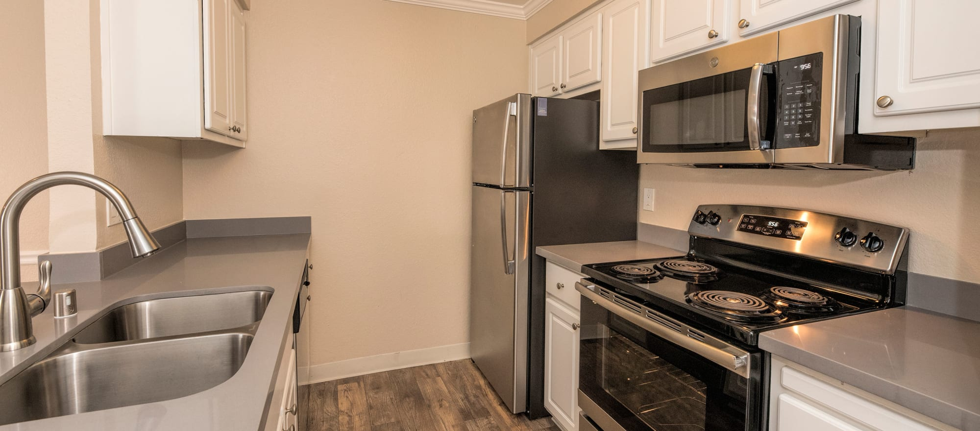Model kitchen with stainless-steel appliances at Sterling Heights Apartment Homes in Benicia, California