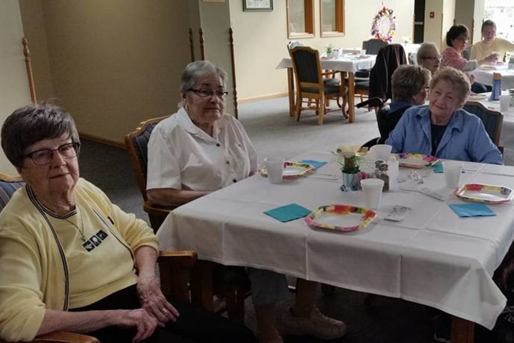 Residents enjoy a party in the dining room at Prairie Meadows Senior Living in Kasson, Minnesota.