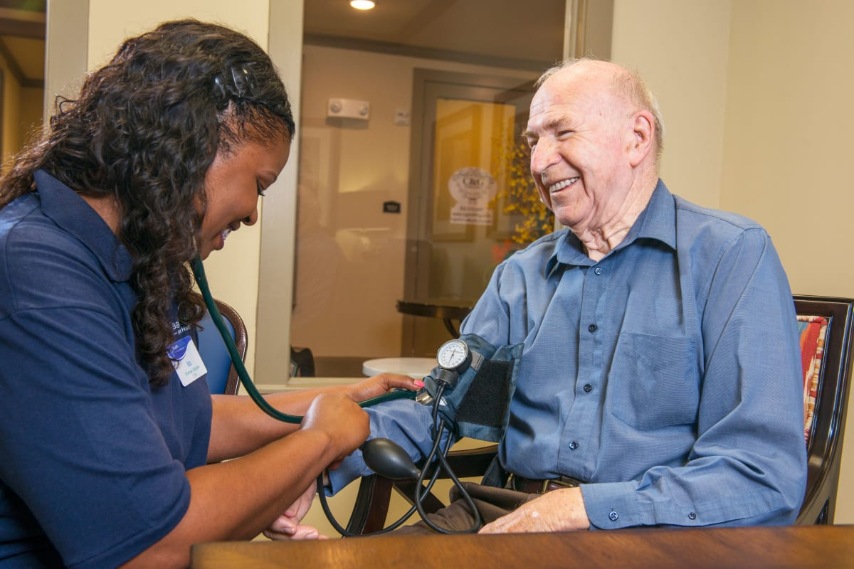 A caretaker with a resident at Watercrest at Mansfield in Mansfield, Texas