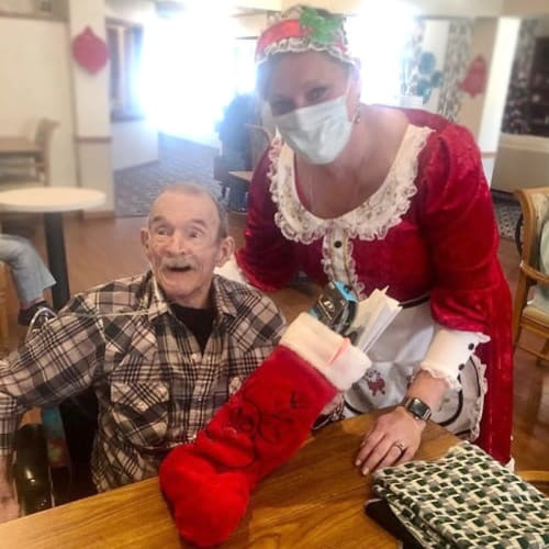 Resident getting a gift from a caretaker at Ashbrook Village in Duncan, Oklahoma