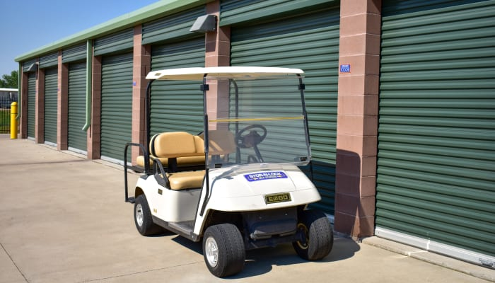 A golf cart in front of exterior storage units at STOR-N-LOCK Self Storage in Fort Collins, Colorado