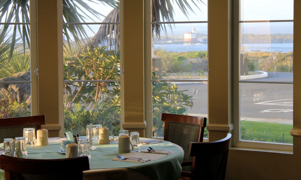 Dining room with view at Pacific View Senior Living Community in Bandon, Oregon