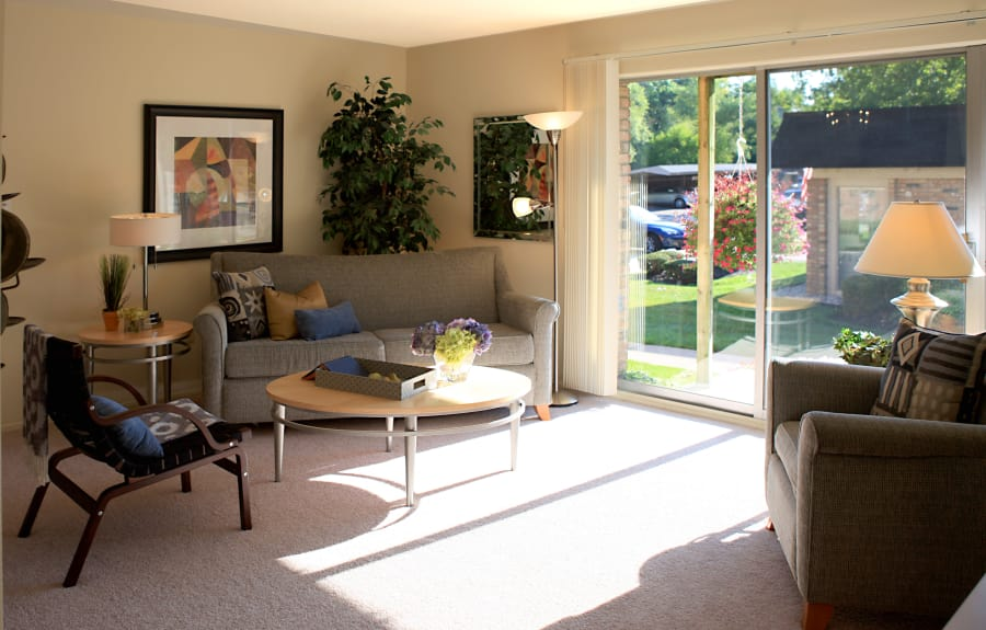 Spacious living room in model home at Kensington Manor Apartments in Farmington, Michigan