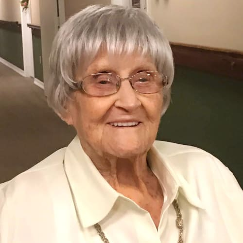 smiling resident in a hallway at Canoe Brook Assisted Living in Duncan, Oklahoma