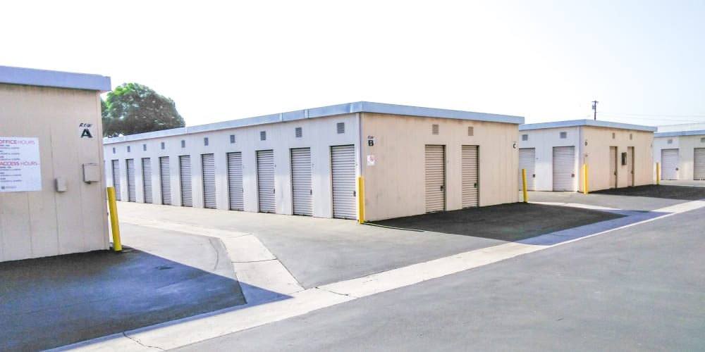 Outdoor storage units with drive-up access at StorQuest Self Storage in Lakewood, California