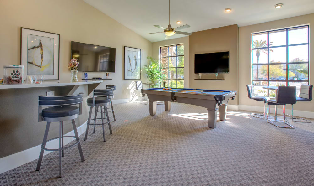 Clubhouse lounge with pool table at Elliot's Crossing Apartment Homes in Tempe