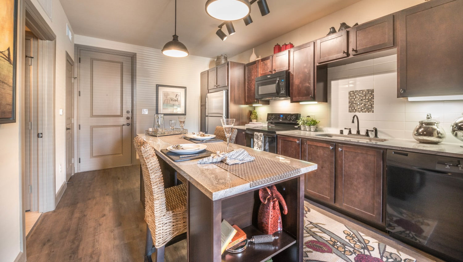 Kitchen with an island in a model home at Union At Carrollton Square in Carrollton, Texas