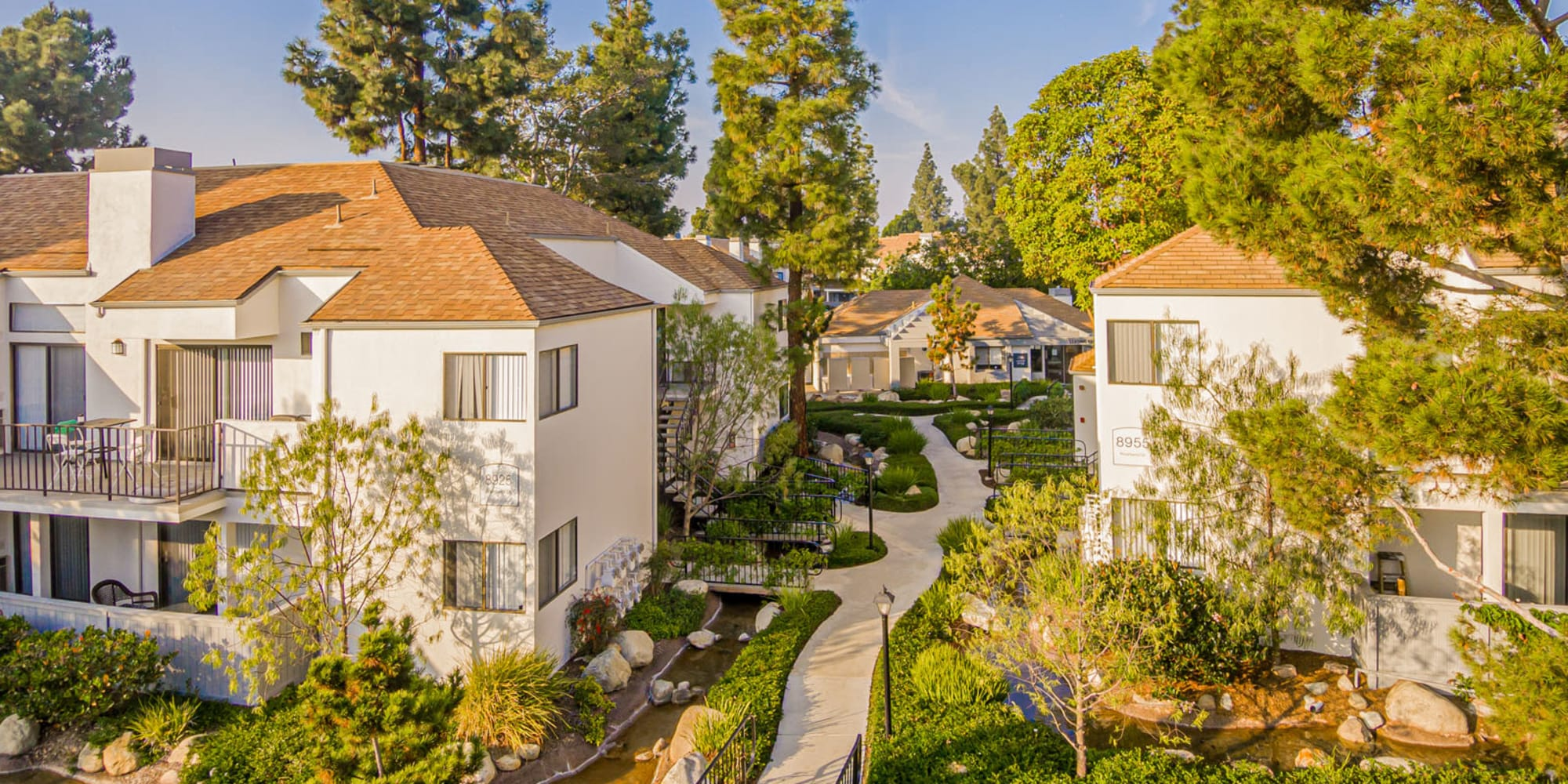 Beautifully maintained grounds and mature trees throughout our community at Sendero Huntington Beach in Huntington Beach, California