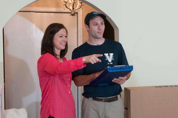 Virginia Varsity Transfer employee performs a walkthrough with a customer.