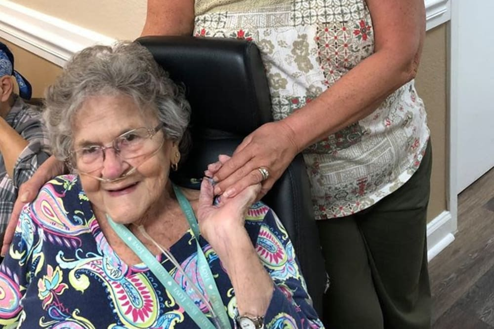A resident being comforted by a guest at Bradenton Oaks in Bradenton, Florida