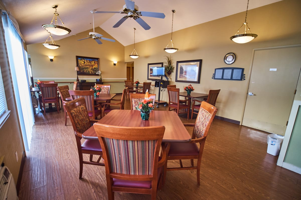Well lit dining room with a piano in it at Farmington Square Beaverton in Beaverton, Oregon