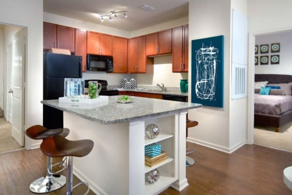 Kitchen island with bar seating in a model home at The Hawthorne in Jacksonville, Florida