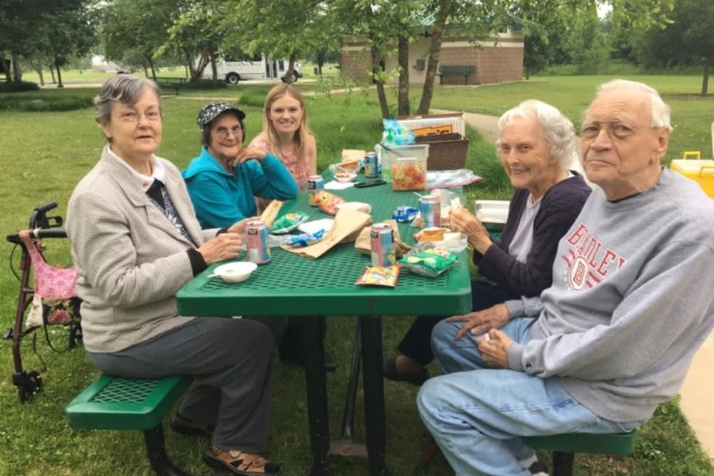 Residents gathered at a picnic table at The Meadowlands in O'Fallon, Missouri