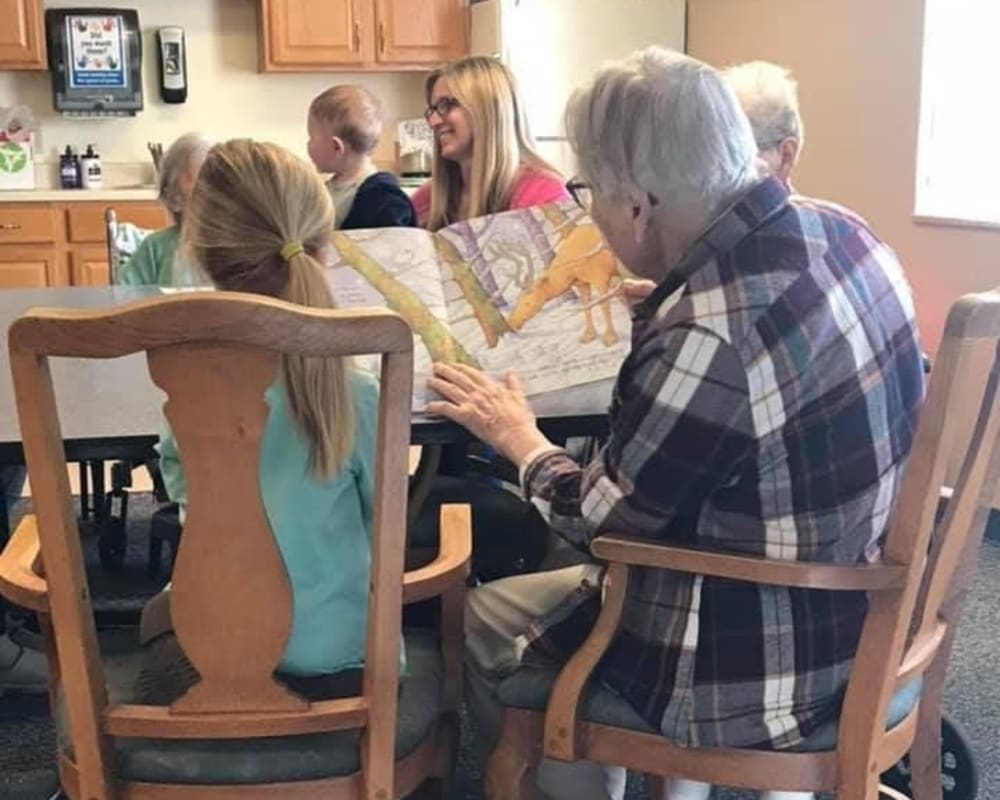 Resident Lois having story time with preschool children for her dare to dream event from Lawton Senior Living in Lawton, Iowa.