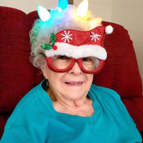 Resident wearing a light-up christmas cap at Alderbrook Village in Arkansas City, Kansas