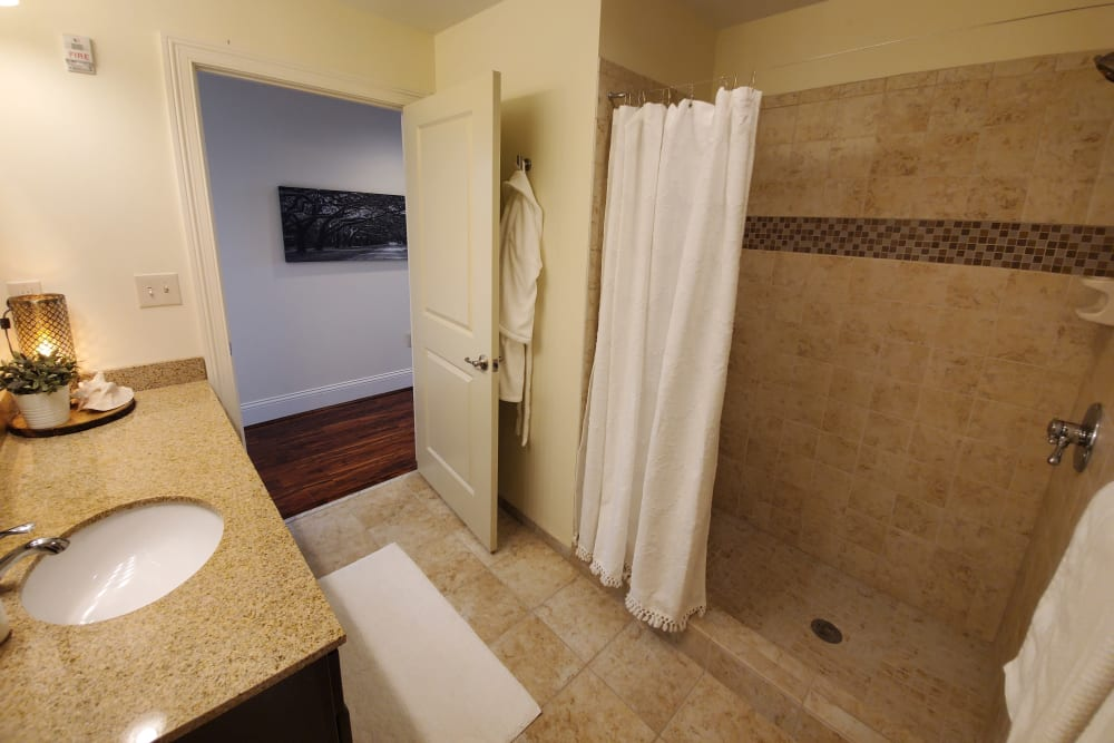 Bathroom with tiled shower at The Reserve at 4th and Race in Cincinnati, Ohio
