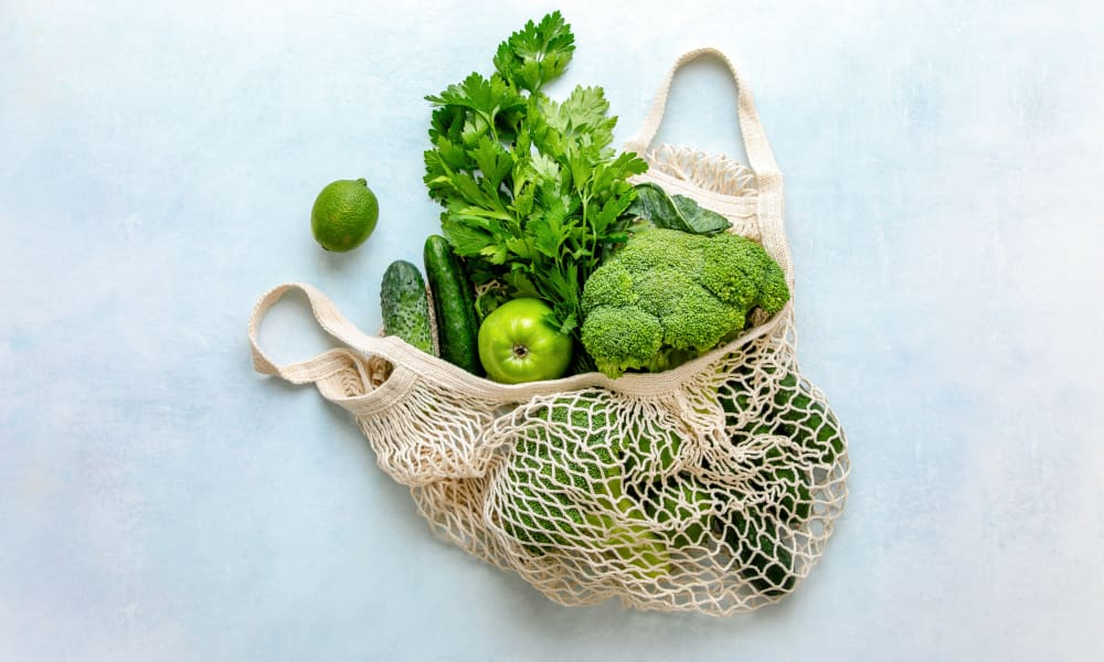 Reusable produce bag fulled with fresh vegetables at Two Twelve Clayton in Clayton, Missouri