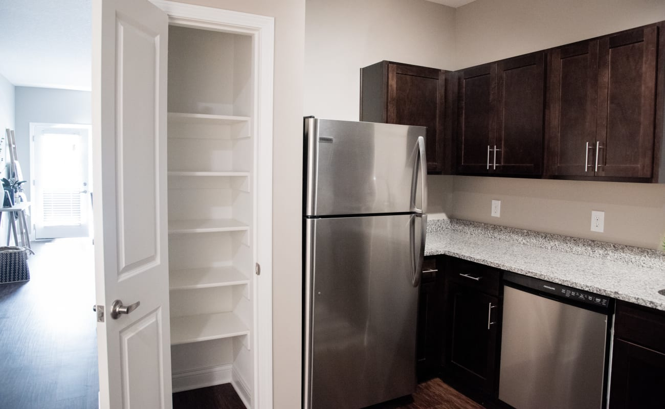 Extra storage in the pantry of a model home's kitchen at Bonterra Apartments in Fort Wayne, Indiana